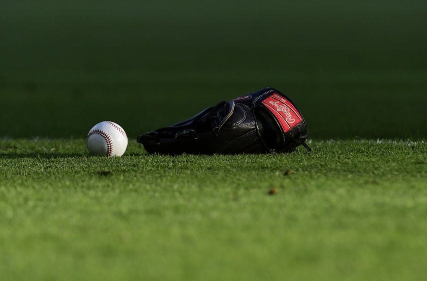 ATLANTA, GEORGIA - AUGUST 22: Detail shot of a bat and glove on the field before the Atlanta Braves vs Miami Marlins game at SunTrust Park on August 22, 2019 in Atlanta, Georgia. (Photo by Logan Riely/Getty Images)