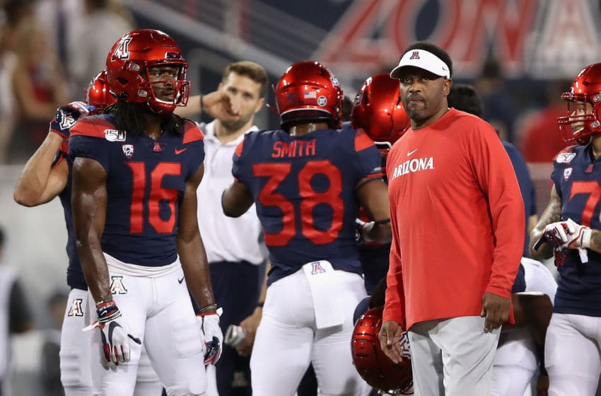 TUCSON, ARIZONA - SEPTEMBER 07: Head coach Kevin Sumlin (R) of the Arizona Wildcats watches warm ups before the NCAAF game against the Northern Arizona Lumberjacks at Arizona Stadium on September 07, 2019 in Tucson, Arizona. (Photo by Christian Petersen/Getty Images)
