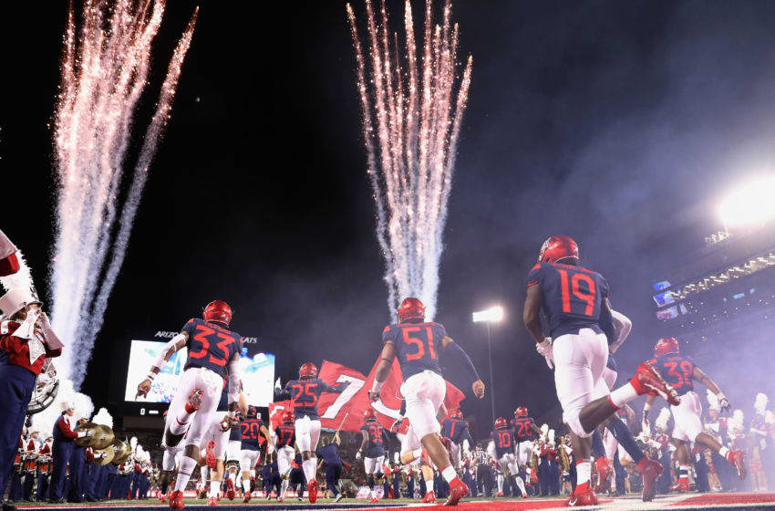 TUCSON, ARIZONA - SEPTEMBER 07: The Arizona Wildcats run out onto the field before the NCAAF game against the Northern Arizona Lumberjacks at Arizona Stadium on September 07, 2019 in Tucson, Arizona. (Photo by Christian Petersen/Getty Images)