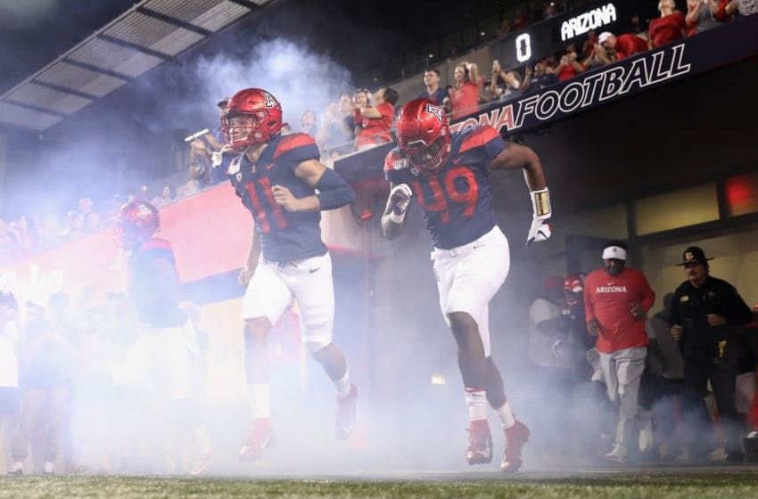 TUCSON, ARIZONA - SEPTEMBER 07: Wide receiver Tayvian Cunningham #11 of the Arizona Wildcats runs out onto the field before the NCAAF game against the Northern Arizona Lumberjacks at Arizona Stadium on September 07, 2019 in Tucson, Arizona. (Photo by Christian Petersen/Getty Images)