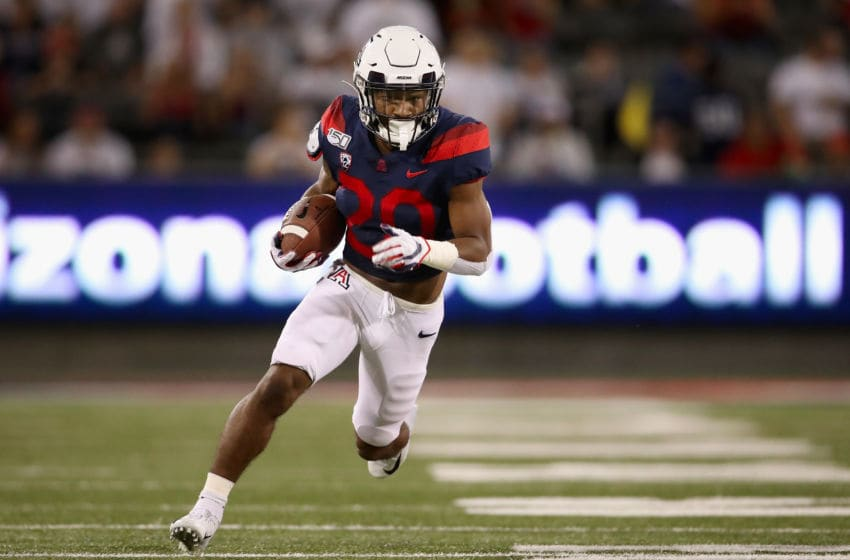 TUCSON, ARIZONA - SEPTEMBER 14: Running back Darrius Smith #20 of the Arizona Wildcats rushes the football against the Texas Tech Red Raiders during the first half of the NCAAF game at Arizona Stadium on September 14, 2019 in Tucson, Arizona. (Photo by Christian Petersen/Getty Images)