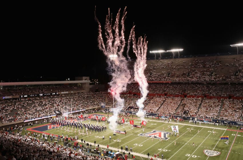 TUCSON, ARIZONA - SEPTEMBER 14: The Arizona Wildcats run onto the field before the start of the NCAAF game against the Texas Tech Red Raiders at Arizona Stadium on September 14, 2019 in Tucson, Arizona. (Photo by Christian Petersen/Getty Images)