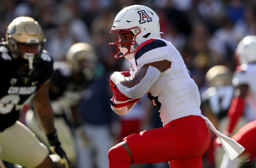 BOULDER, COLORADO - OCTOBER 05: Michael Wiley #6 of the Arizona Wildcats carries the ball against the Colorado Buffaloes in the second quarter at Folsom Field on October 05, 2019 in Boulder, Colorado. (Photo by Matthew Stockman/Getty Images)