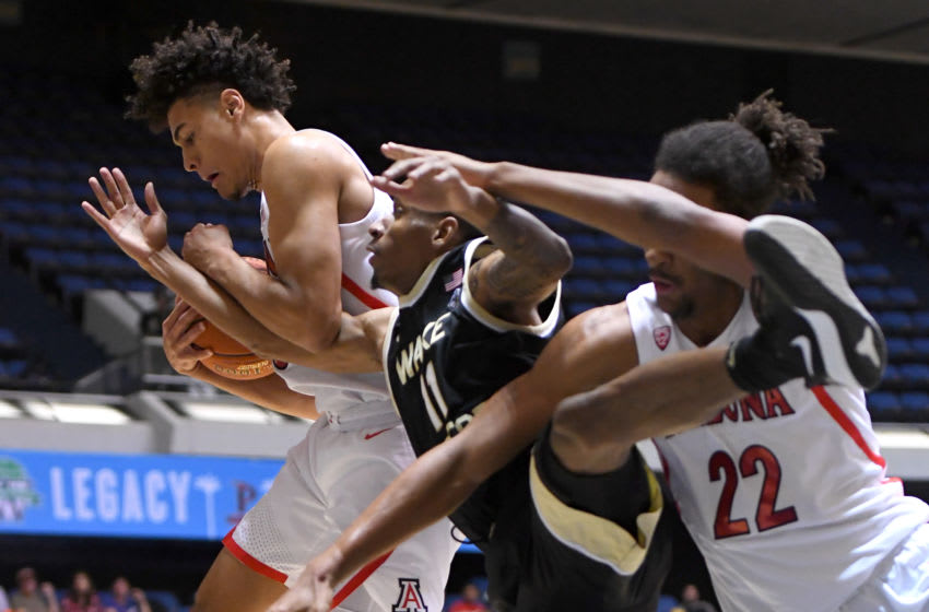 ANAHEIM, CA - DECEMBER 01: Josh Green #0 and Zeke Nnaji #22 of the Arizona Wildcats and Torry Johnson #11 of the Wake Forest Demon Deacons battle for a rebound in the first half of the game during the Wooden Legacy at the Anaheim Convention Center at on December 1, 2019 in Anaheim, California. (Photo by Jayne Kamin-Oncea/Getty Images)