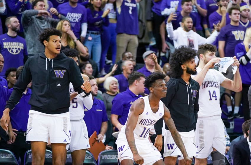 SEATTLE, WA - DECEMBER 08: Elijah Hardy #10 and Sam Timmins #14 of the Washington Huskies celebrate with teammates and fans as the Huskies attempt a comeback in the 2nd half against the Gonzaga Bulldogs at Hec Edmundson Pavilion on December 8, 2019 in Seattle, Washington. (Photo by Mike Tedesco/Getty Images)