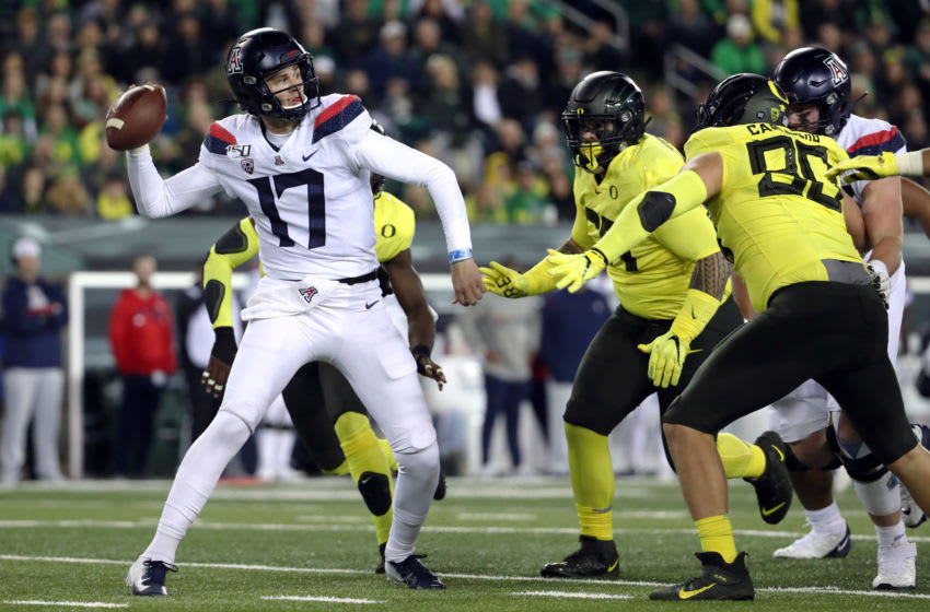 EUGENE, OREGON - NOVEMBER 16: Grant Gunnell #17 of the Arizona Wildcats throws the ball under pressure in the first quarter against the Oregon Ducks during their game at Autzen Stadium on November 16, 2019 in Eugene, Oregon. (Photo by Abbie Parr/Getty Images)