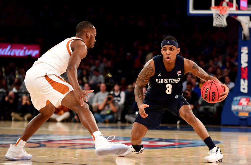 NEW YORK, NEW YORK - NOVEMBER 21: James Akinjo #3 of the Georgetown Hoyas drives past Matt Coleman III #2 of the Texas Longhorns during the first half of their game at Madison Square Garden on November 21, 2019 in New York City. (Photo by Emilee Chinn/Getty Images)