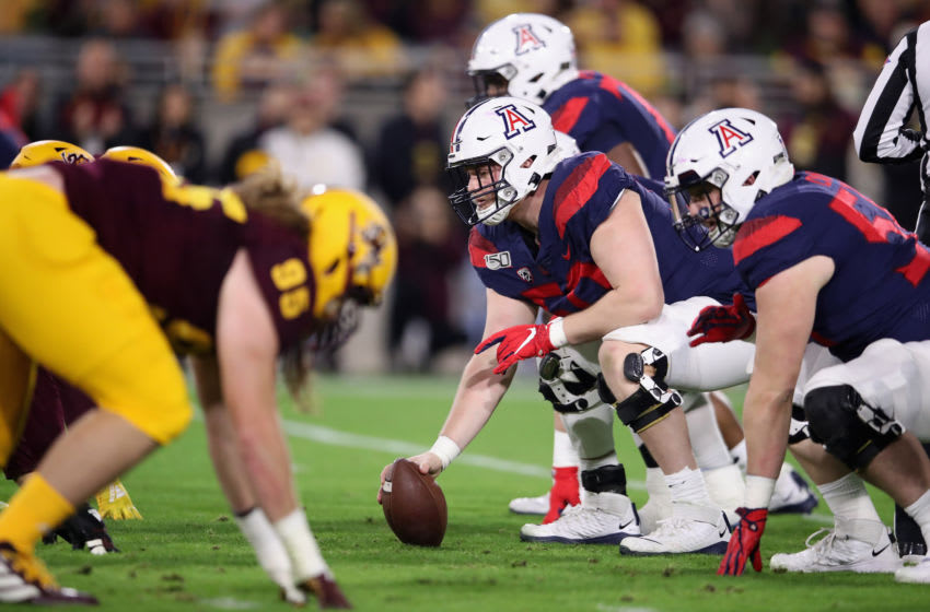 TEMPE, ARIZONA - NOVEMBER 30: Offensive lineman Josh McCauley #50 of the Arizona Wildcats prepares to snap the football against Arizona State Sun Devils during the first half of the NCAAF game at Sun Devil Stadium on November 30, 2019 in Tempe, Arizona. (Photo by Christian Petersen/Getty Images)