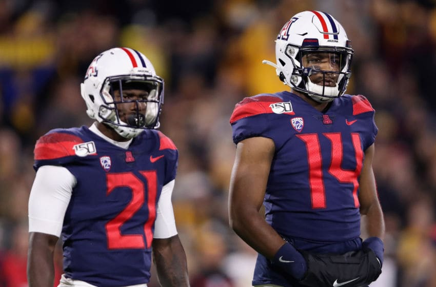 TEMPE, ARIZONA - NOVEMBER 30: Quarterback Khalil Tate (R) #14 of the Arizona Wildcats stands alongside running back J.J. Taylor #21 during the first half of the NCAAF game against the Arizona State Sun Devils at Sun Devil Stadium on November 30, 2019 in Tempe, Arizona. (Photo by Christian Petersen/Getty Images)