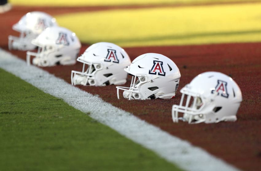 LOS ANGELES, CALIFORNIA - OCTOBER 19: Arizona Wildcats helmets line the field ahead of the game against the USC Trojans at Los Angeles Memorial Coliseum on October 19, 2019 in Los Angeles, California. (Photo by Meg Oliphant/Getty Images)