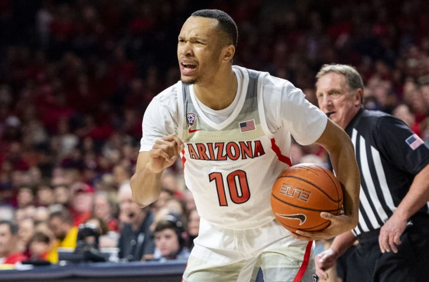 TUCSON, ARIZONA - JANUARY 04: Jemarl Baker Jr. #10 of the Arizona Wildcats reacts while holding the ball in the first half against the Arizona State Sun Devils at McKale Center on January 04, 2020 in Tucson, Arizona. The Arizona Wildcats won 75-47. (Photo by Jennifer Stewart/Getty Images)