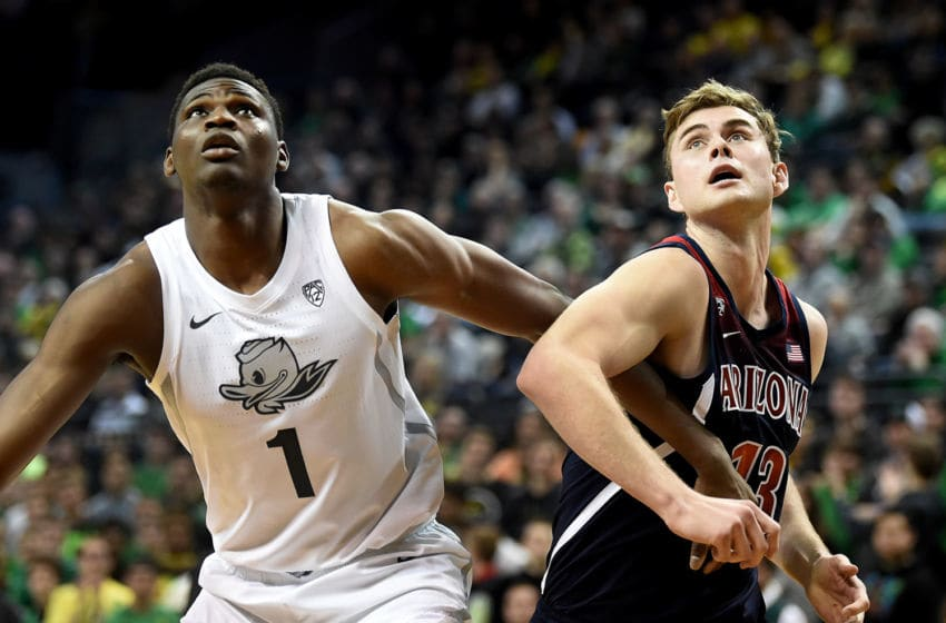 EUGENE, OREGON - JANUARY 09: N'Faly Dante #1 of the Oregon Ducks battles for a rebound with Stone Gettings #13 of the Arizona Wildcats during the second half at Matthew Knight Arena on January 09, 2020 in Eugene, Oregon. Oregon won 74-73. (Photo by Steve Dykes/Getty Images)