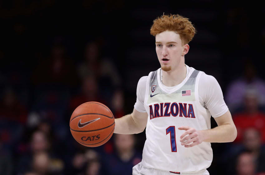 TUCSON, ARIZONA - JANUARY 16: Nico Mannion #1 of the Arizona Wildcats handles the ball during the first half of the NCAA men's basketball game against the Utah Utes at McKale Center on January 16, 2020 in Tucson, Arizona. (Photo by Christian Petersen/Getty Images)