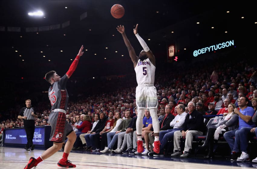 TUCSON, ARIZONA - JANUARY 16: Max Hazzard #5 of the Arizona Wildcats attempts a three point shot over Rylan Jones #15 of the Utah Utes during the first half of the NCAA men's basketball game at McKale Center on January 16, 2020 in Tucson, Arizona. (Photo by Christian Petersen/Getty Images)