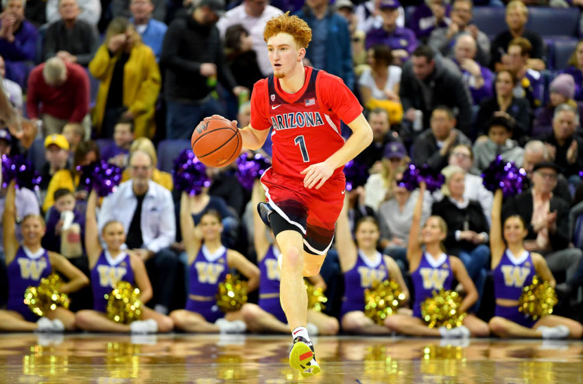SEATTLE, WASHINGTON - JANUARY 30: Nico Mannion #1 of the Arizona Wildcats brings the ball up court during the second half of the game against the Washington Huskies at Hec Edmundson Pavilion on January 30, 2020 in Seattle, Washington. The Arizona Wildcats top the Washington Huskies, 75-72. (Photo by Alika Jenner/Getty Images)
