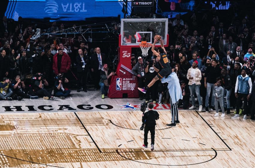 CHICAGO, ILLINOIS - FEBRUARY 15: Aaron Gordon #00 of the Orlando Magic dunks the ball over Tacko Fall of the Boston Celtics in the 2020 NBA All-Star - AT&T Slam Dunk Contest during State Farm All-Star Saturday Night at the United Center on February 15, 2020 in Chicago, Illinois. (Photo by Lampson Yip - Clicks Images/Getty Images)