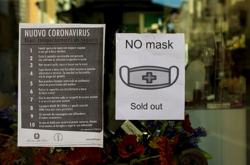 ROME, ITALY - MARCH 11: A pharmacy in the center of Rome displays a sign informing the protective masks are sold out on March 11, 2020 in Rome, Italy. The Italian Government has taken the unprecedented measure of a nationwide lockdown in an effort to fight the world's second-most deadly coronavirus (Covid-19) outbreak outside of China. The movements in and out are allowed only for work and health reasons proven by a medical certificate. The justifications for the movements needs to be certified with a self-declaration by filling in forms provided by the police forces in charge of the check. (Photo by Stefano Montesi - Corbis/ Getty Images)