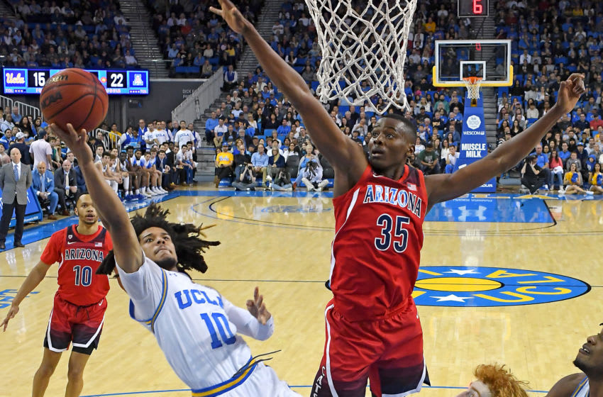 LOS ANGELES, CA - FEBRUARY 29: Tyger Campbell #10 of the UCLA Bruins gets by Christian Koloko #35 of the Arizona Wildcats for a basket in the game at Pauley Pavilion on February 29, 2020 in Los Angeles, California. (Photo by Jayne Kamin-Oncea/Getty Images)