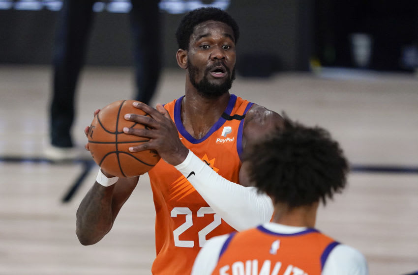 LAKE BUENA VISTA, FLORIDA - AUGUST 02: Deandre Ayton #22 of the Phoenix Suns looks to pass against the Dallas Mavericks during the second half at Visa Athletic Center at ESPN Wide World Of Sports Complex on August 2, 2020 in Lake Buena Vista, Florida. NOTE TO USER: User expressly acknowledges and agrees that, by downloading and or using this photograph, User is consenting to the terms and conditions of the Getty Images License Agreement. (Photo by Ashley Landis-Pool/Getty Images)