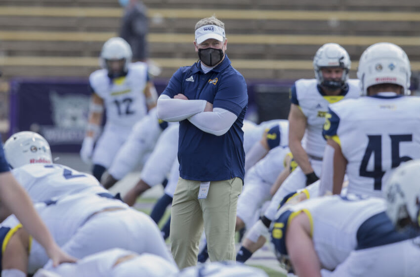 OGDEN, UT - MARCH 27: Head coach Chris Ball of the Northern Arizona Lumberjacks watches his team warm up before their game against the Weber State Wildcats on March 27, 2021 at Stewart Stadium in Ogden, UT. (Photo by Chris Gardner/Getty Images)