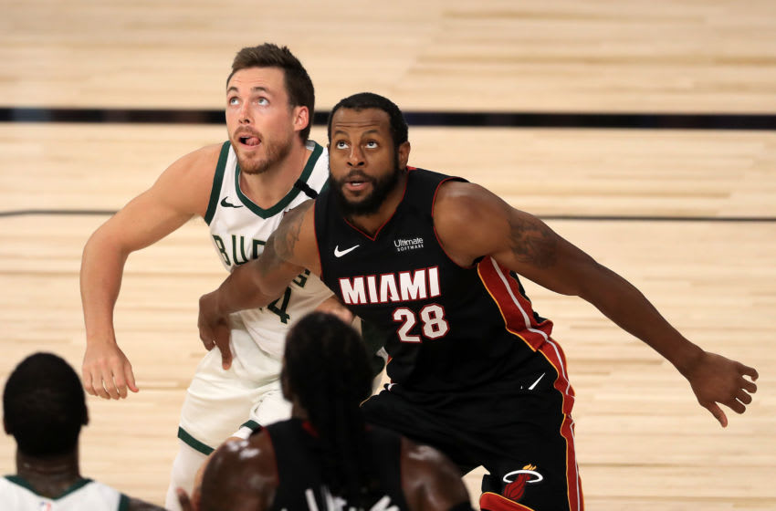 LAKE BUENA VISTA, FLORIDA - AUGUST 31: Pat Connaughton #24 of the Milwaukee Bucks and Andre Iguodala #28 of the Miami Heat wait for an inbound ball during the third quarter in Game One of the Eastern Conference Second Round during the 2020 NBA Playoffs at the Field House at ESPN Wide World Of Sports Complex on August 31, 2020 in Lake Buena Vista, Florida. NOTE TO USER: User expressly acknowledges and agrees that, by downloading and or using this photograph, User is consenting to the terms and conditions of the Getty Images License Agreement. (Photo by Mike Ehrmann/Getty Images)