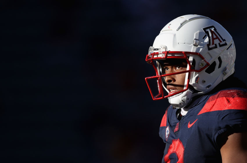 TUCSON, ARIZONA - NOVEMBER 14: Running back Gary Brightwell #0 of the Arizona Wildcats walks onto the field during the second half of the PAC-12 football game against the USC Trojans at Arizona Stadium on November 14, 2020 in Tucson, Arizona. The Trojans defeated the Wildcats 34-30. (Photo by Christian Petersen/Getty Images)
