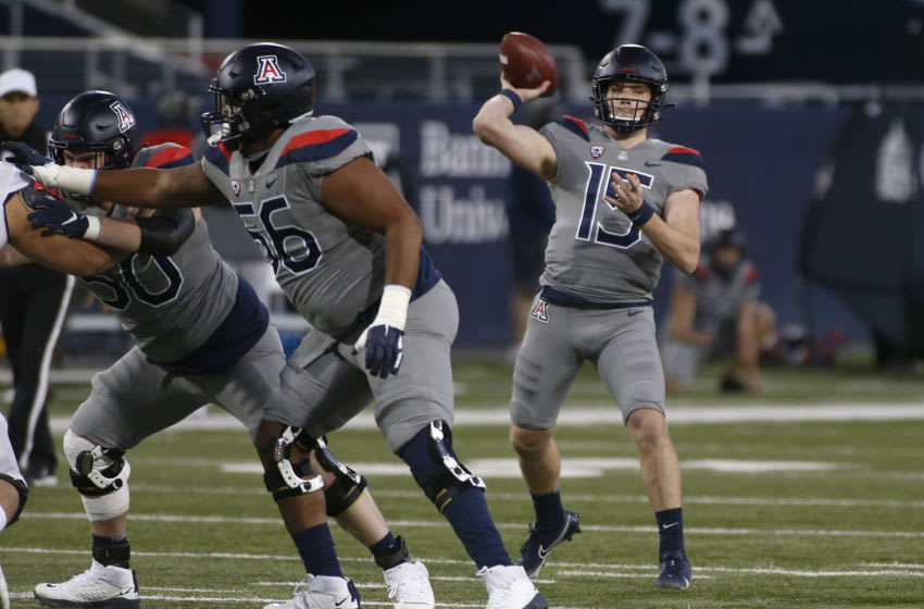 TUCSON, ARIZONA - DECEMBER 05: Quarterback Will Plummer #15 of the Arizona Wildcats throws a pass against the Colorado Buffaloes during the first half of the PAC-12 football game at Arizona Stadium on December 05, 2020 in Tucson, Arizona. (Photo by Ralph Freso/Getty Images)