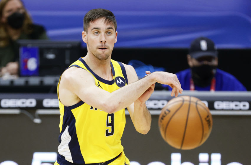 PHILADELPHIA, PENNSYLVANIA - MARCH 01: T.J. McConnell #9 of the Indiana Pacers passes during the second quarter against the Philadelphia 76ers at Wells Fargo Center on March 01, 2021 in Philadelphia, Pennsylvania. NOTE TO USER: User expressly acknowledges and agrees that, by downloading and or using this photograph, User is consenting to the terms and conditions of the Getty Images License Agreement. (Photo by Tim Nwachukwu/Getty Images)