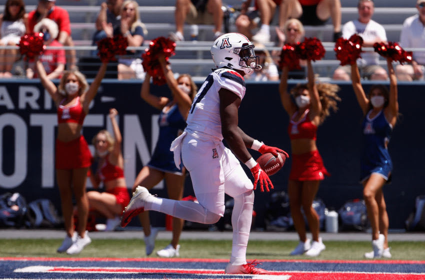 TUCSON, ARIZONA - APRIL 24: Wide receiver Stacey Marshall Jr. #87 of the Arizona Wildcats (Team Red) catches a touchdown reception in the Arizona Spring game at Arizona Stadium on April 24, 2021 in Tucson, Arizona. (Photo by Christian Petersen/Getty Images)