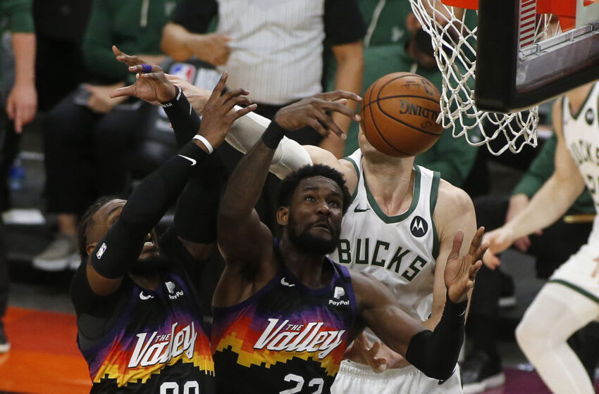 PHOENIX, ARIZONA - JULY 08: Deandre Ayton #22, Jae Crowder #99 of the Phoenix Suns and Brook Lopez #11 of the Milwaukee Bucks go after a rebound during the second half in Game Two of the NBA Finals at Phoenix Suns Arena on July 08, 2021 in Phoenix, Arizona. NOTE TO USER: User expressly acknowledges and agrees that, by downloading and or using this photograph, User is consenting to the terms and conditions of the Getty Images License Agreement. (Photo by Ralph Freso/Getty Images)