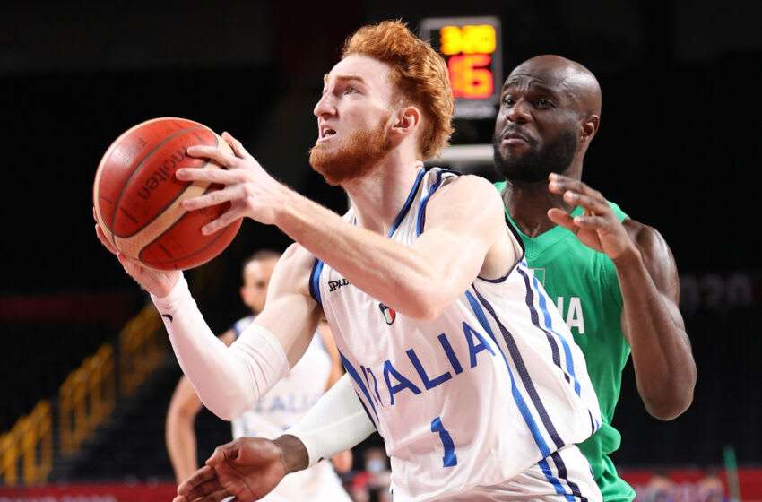 SAITAMA, JAPAN - JULY 31: Niccolo Mannion #1 of Team Italy drives to the basket against Obi Emegano #11 of Team Nigeria during the first half of a Men's Basketball Preliminary Round Group B game on day eight of the Tokyo 2020 Olympic Games at Saitama Super Arena on July 31, 2021 in Saitama, Japan. (Photo by Gregory Shamus/Getty Images)