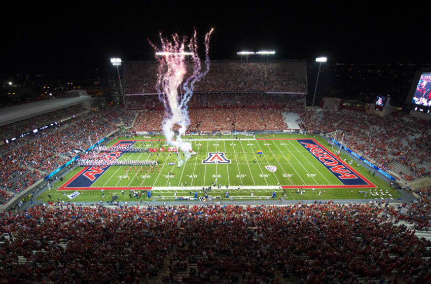 TUCSON, AZ - SEPTEMBER 13: The Arizona Wildcats take the field with fireworks to start the game against the Nevada Wolf Pack at Arizona Stadium on September 13, 2014 in Tucson, Arizona. (Photo by Paul Dye/J and L Photography/Getty Images )