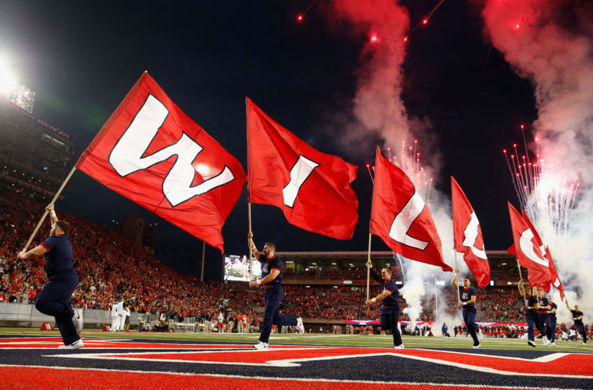 TUCSON, AZ - SEPTEMBER 03: Arizona Wildcats flags are run arcross the field before the college football game against the UTSA Roadrunners at Arizona Stadium on September 3, 2015 in Tucson, Arizona. (Photo by Christian Petersen/Getty Images)