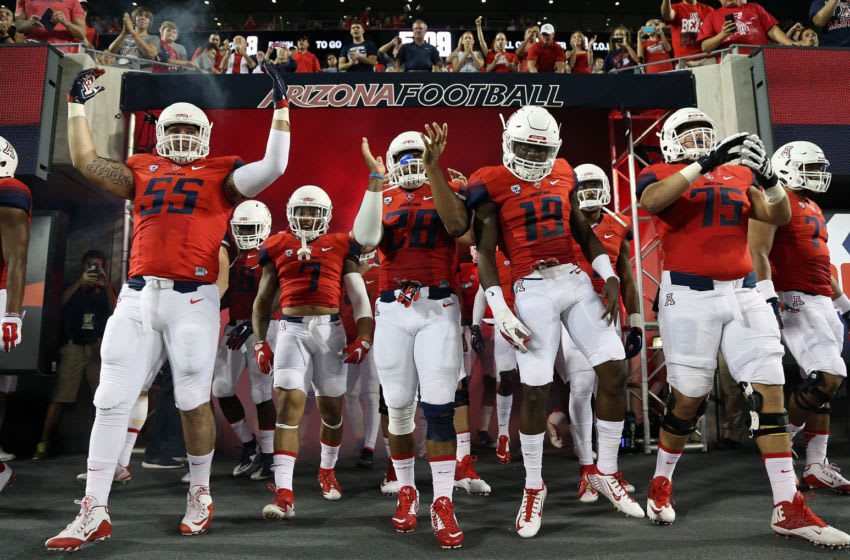TUCSON, AZ - SEPTEMBER 19: (L-R) Defensive lineman Jeff Worthy #55 of the Arizona Wildcats, safety Jamar Allah #7, safety Anthony Lopez #28, cornerback DaVonte' Neal #19 and offensive lineman Kaige Lawrence #75 wait to enter the field before the college football game against the Northern Arizona Lumberjacks at Arizona Stadium on September 19, 2015 in Tucson, Arizona. (Photo by Chris Coduto/Getty Images)