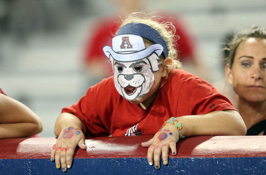 TUCSON, AZ - SEPTEMBER 19: A young Arizona Wildcats fan watches the fourth quarter of the college football game against the Northern Arizona Lumberjacks at Arizona Stadium on September 19, 2015 in Tucson, Arizona. (Photo by Chris Coduto/Getty Images)