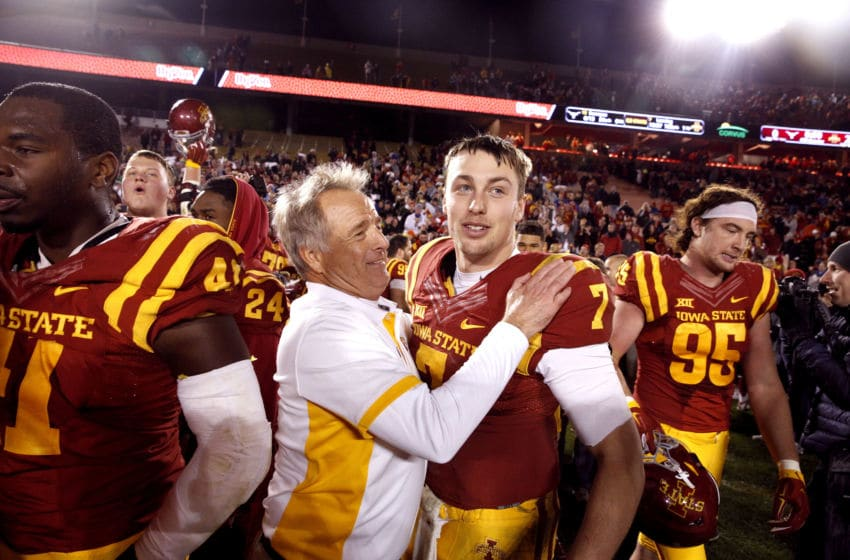 AMES, IA â OCTOBER 31: Defensive ends coach Stan Eggen of the Iowa State Cyclones celebrates with quarterback Joel Lanning #7 of the Iowa State Cyclones after Iowa State defeated Texas Longhorns 24-0 at Jack Trice Stadium on October 31, 2015 in Ames, Iowa. Iowa State defeated Texas 24-0. (Photo by David Purdy/Getty Images)