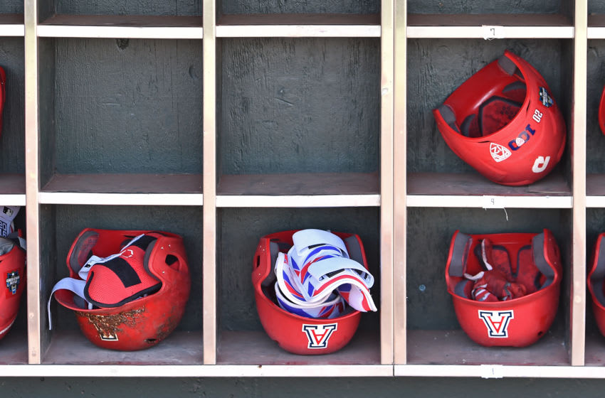 Omaha, NE - JUNE 28: A general view of the Arizona Wildcats helmet rack in the dugout prior to game two of the College World Series Championship Series against the Coastal Carolina Chanticleers on June 28, 2016 at TD Ameritrade Park in Omaha, Nebraska. (Photo by Peter Aiken/Getty Images)