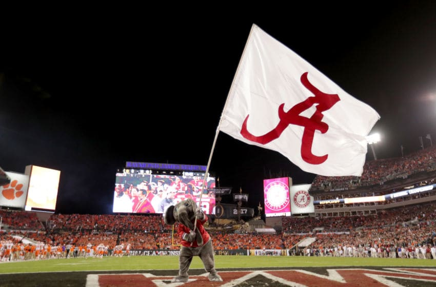 TAMPA, FL - JANUARY 09: Alabama Crimson Tide mascot Big Al waves a flag in the end zone during the first half of the 2017 College Football Playoff National Championship Game between the Alabama Crimson Tide and the Clemson Tigers at Raymond James Stadium on January 9, 2017 in Tampa, Florida. (Photo by Ronald Martinez/Getty Images)