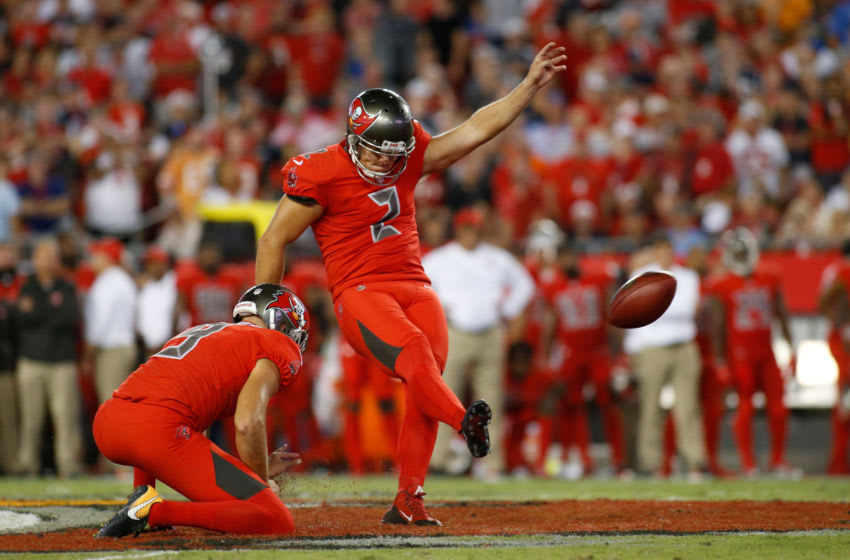 TAMPA, FL - OCTOBER 5: Kicker Nick Folk #2 of the Tampa Bay Buccaneers gets a hold form punter Bryan Anger #9 as he misses a 56-yard field goal attempt during the second quarter of an NFL football game against the New England Patriots on October 5, 2017 at Raymond James Stadium in Tampa, Florida. (Photo by Brian Blanco/Getty Images)