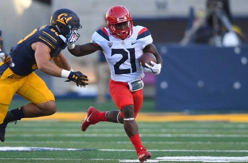 BERKELEY, CA - OCTOBER 21: J.J. Taylor #21 of the Arizona Wildcats carries the ball against the California Golden Bears during their NCAA football game at California Memorial Stadium on October 21, 2017 in Berkeley, California. (Photo by Thearon W. Henderson/Getty Images)
