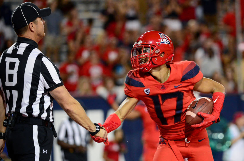 TUCSON, AZ - OCTOBER 28: Cornerback Jace Whittaker #17 of the Arizona Wildcats shakes hands with back judge Brad Robinson after making an interception in the second half of the game against the Washington State Cougars at Arizona Stadium on October 28, 2017 in Tucson, Arizona. The Arizona Wildcats won 58-37. (Photo by Jennifer Stewart/Getty Images)