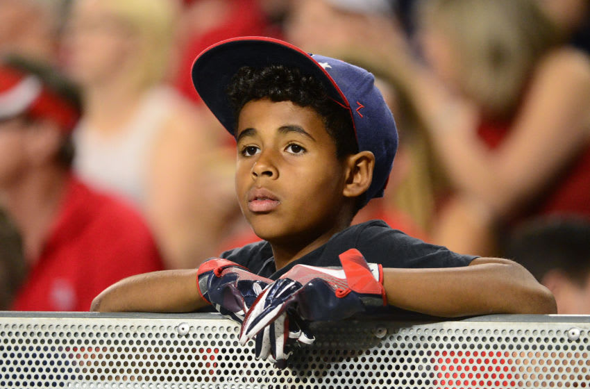 TUCSON, AZ - OCTOBER 28: An Arizona Wildcats fan watches the game between the Washington State Cougars and Arizona Wildcats at Arizona Stadium on October 28, 2017 in Tucson, Arizona. The Arizona Wildcats won 58-37. (Photo by Jennifer Stewart/Getty Images)