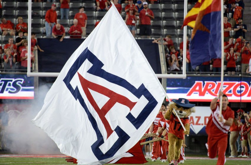 TUCSON, AZ - OCTOBER 28: The Arizona Wildcats mascot runs on the field with an Arizona Wildcats flag for the game between the Washington State Cougars and Arizona Wildcats at Arizona Stadium on October 28, 2017 in Tucson, Arizona. The Arizona Wildcats won 58-37. (Photo by Jennifer Stewart/Getty Images)