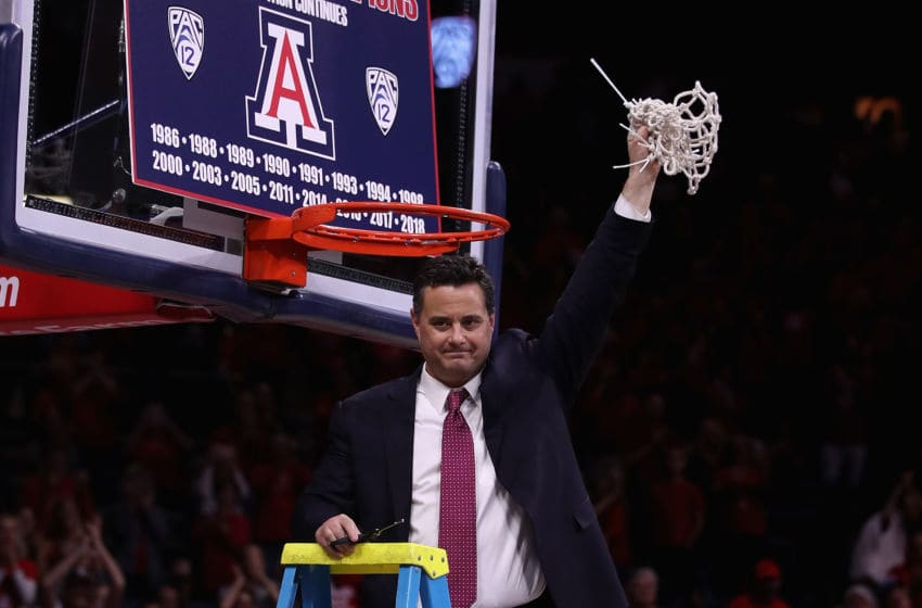 TUCSON, AZ - MARCH 03: Head coach Sean Miller of the Arizona Wildcats cuts down the nets after defeating the California Golden Bears 66-54 to win the PAC-12 Championship at McKale Center on March 3, 2018 in Tucson, Arizona. (Photo by Christian Petersen/Getty Images)