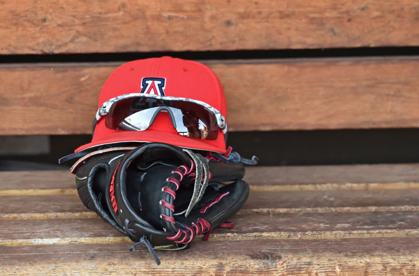 Omaha, NE - JUNE 28: A general view of an Arizona Wildcats glove and cap on the bench in the dugout, prior to game two of the College World Series Championship Series against the Coastal Carolina Chanticleers on June 28, 2016 at TD Ameritrade Park in Omaha, Nebraska. (Photo by Peter Aiken/Getty Images)