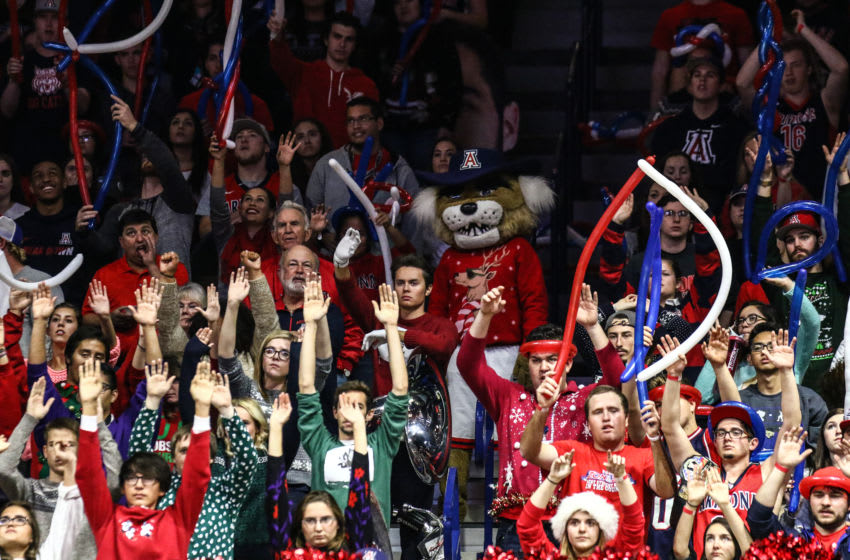 TUCSON, AZ - DECEMBER 13: Fans of the Arizona Wildcats raise their hands to distract the Tigers during the second half of the college basketball game at McKale Center on December 13, 2015 in Tucson, Arizona.(Photo by Nils Nilsen/Getty Images)