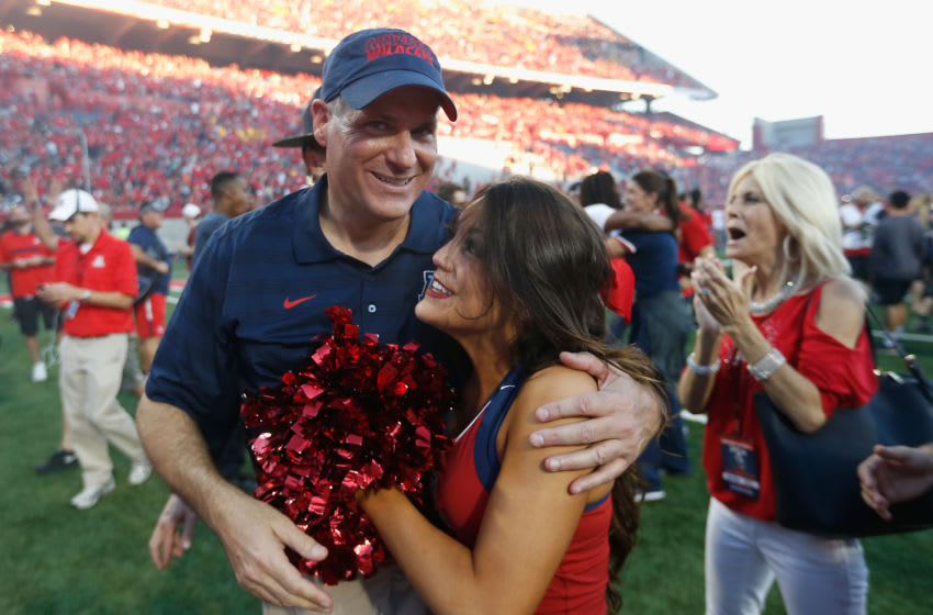 TUCSON, AZ - NOVEMBER 28: Head coach Rich Rodriguez of the Arizona Wildcats celebrates with daughter Raquel after defeating the Arizona State Sun Devils 42-35 to win the PAC-12 south championship following the Territorial Cup college football game at Arizona Stadium on November 28, 2014 in Tucson, Arizona. (Photo by Christian Petersen/Getty Images)