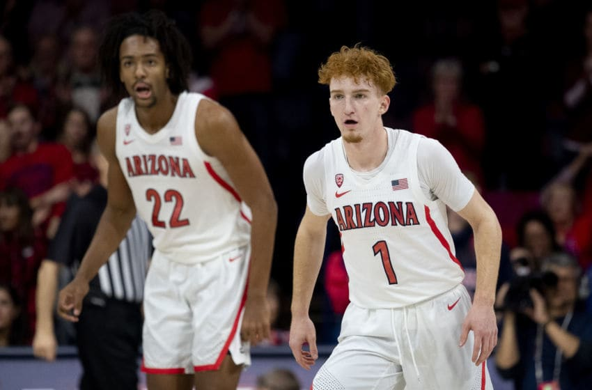 TUCSON, ARIZONA - DECEMBER 14: Nico Mannion #1 and Zeke Nnaji #22 of the Arizona Wildcats in action against the Gonzaga Bulldogs at McKale Center on December 14, 2019 in Tucson, Arizona. The Gonzaga Bulldogs won 84 - 80. (Photo by Jennifer Stewart/Getty Images)