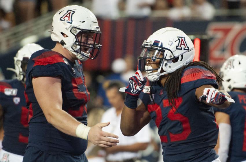 Sep 14, 2019; Tucson, AZ, USA; Arizona Wildcats running back Gary Brightwell (23) celebrates a touchdown against the Texas Tech Red Raiders during the second half at Arizona Stadium. Mandatory Credit: Casey Sapio-USA TODAY Sports
