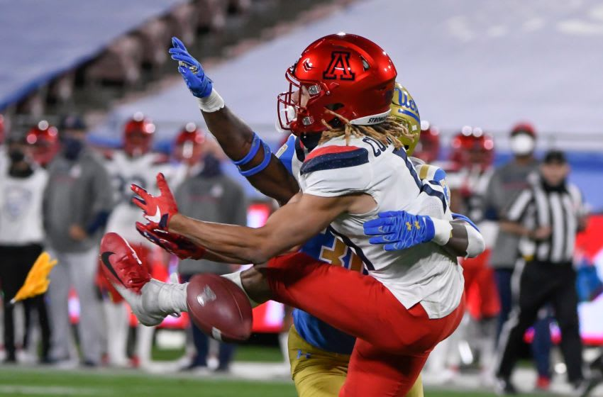 Nov 28, 2020; Pasadena, California, USA; Arizona Wildcats wide receiver Tayvian Cunningham (11) collides with UCLA Bruins defensive back Elisha Guidry (30) during a third quarter pass play at Rose Bowl. Guidry was call for a penalty on the play. Mandatory Credit: Robert Hanashiro-USA TODAY Sports